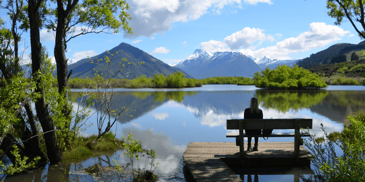 woman sitting at a lake NZ
