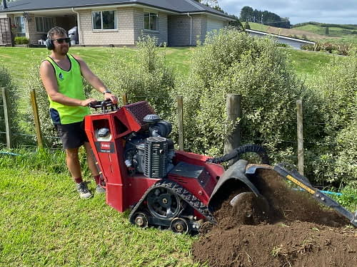 trencher with operator at work